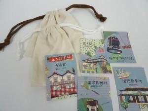 サンプルの巾着を取り寄せ、サイズの決定。デザインは丸亀出身のパッチワーク作家、アオキタカエさんに。アオキさんデザインの丸亀トレカ。かわいい!